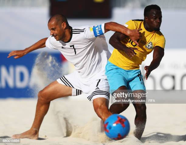 Madjer of the Allstars battles for the ball with Lesly St Fleur of Bahamas during the FIFA Beach Soccer World Cup Bahamas 2017 Exhibition match...