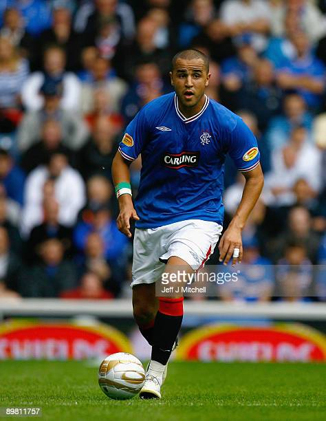 Madjid Bougherra of Rangers in action during the Scottish Premier League match between Rangers and Falkirk at Ibrox Stadium on August 15 2009 in...