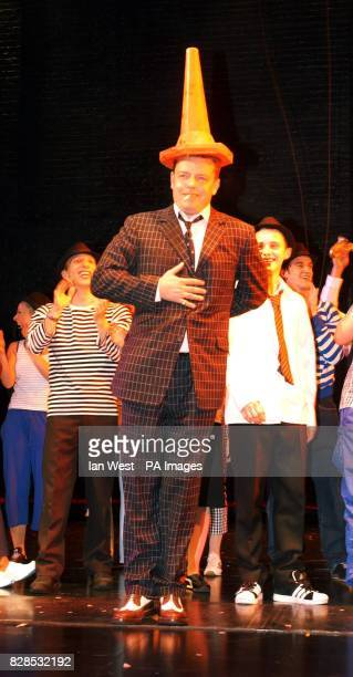 Madness frontman Suggs on stage at the Cambridge Theatre in London for the opening night of 'Our House' the musical a comedy woven around the...