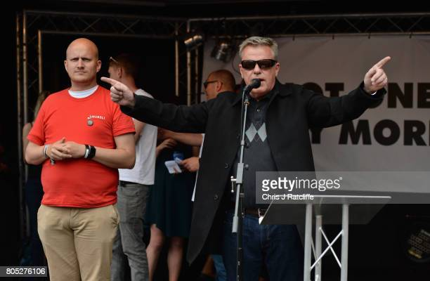 Madness frontman Suggs speaks to demonstrators during the 'Not One Day More' march at Parliament Square on July 1 2017 in London England Thousands of...