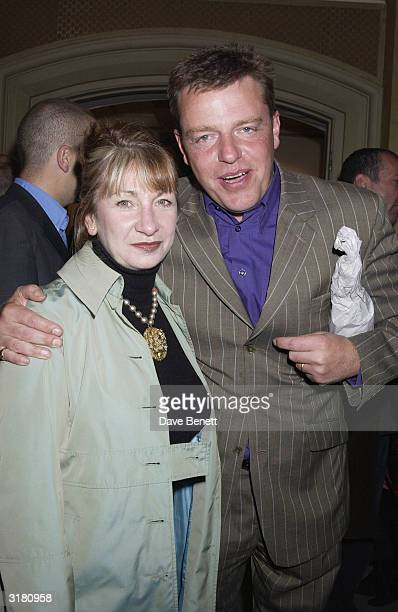 Madness lead singer Suggs with his wife at the private viewing of Ex Clash bass guitarist Paul Simonon's new exhibition 'Scenes of London' at the...