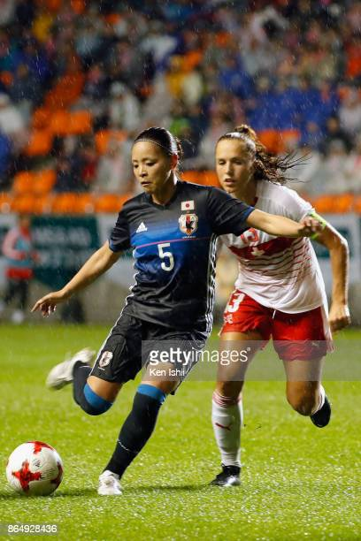 Madoka Haji of Japan controls the ball under pressure of Lia Walti of Switzerland during the international friendly match between Japan and...