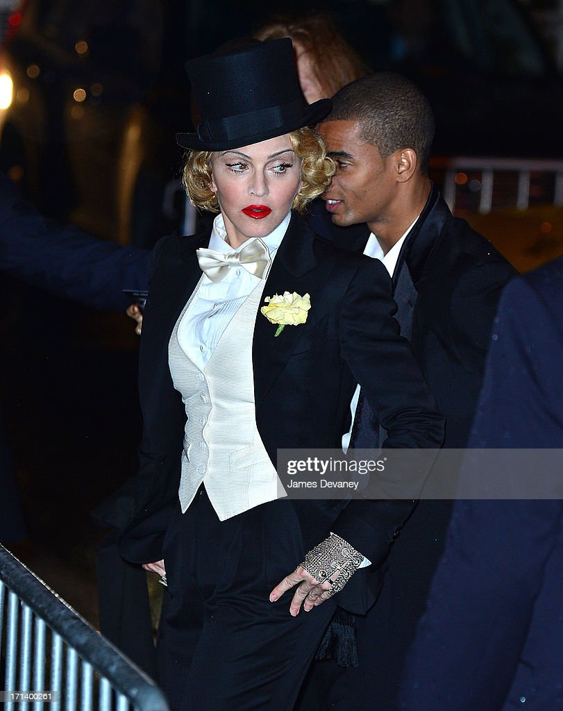 <a gi-track='captionPersonalityLinkClicked' href=/galleries/search?phrase=Madonna+-+Singer&family=editorial&specificpeople=156408 ng-click='$event.stopPropagation()'>Madonna</a> and <a gi-track='captionPersonalityLinkClicked' href=/galleries/search?phrase=Brahim+Zaibat&family=editorial&specificpeople=7494039 ng-click='$event.stopPropagation()'>Brahim Zaibat</a> attends the Dolce & Gabbana and The Cinema Society screening of the Epix World premiere of '<a gi-track='captionPersonalityLinkClicked' href=/galleries/search?phrase=Madonna+-+Singer&family=editorial&specificpeople=156408 ng-click='$event.stopPropagation()'>Madonna</a>: The MDNA Tour' at The Paris Theatre on June 18, 2013 in New York City.