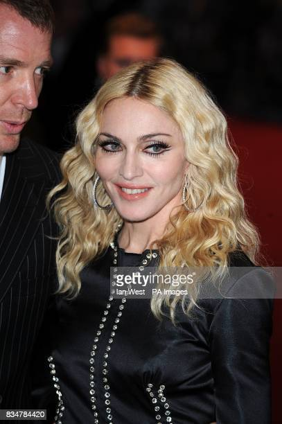 Madonna and Guy Ritchie arrive for the UK Film Premiere of RocknRolla at the Odeon West End Cinema Leicester Square London