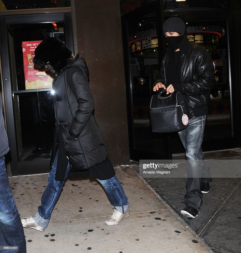 <a gi-track='captionPersonalityLinkClicked' href=/galleries/search?phrase=Madonna+-+Singer&family=editorial&specificpeople=156408 ng-click='$event.stopPropagation()'>Madonna</a> and her boyfriend <a gi-track='captionPersonalityLinkClicked' href=/galleries/search?phrase=Jesus+Luz&family=editorial&specificpeople=5706946 ng-click='$event.stopPropagation()'>Jesus Luz</a> walk out of a movie theatre on January 6, 2010 in New York City.