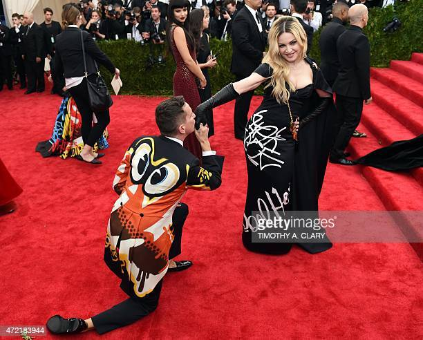 Madonna and Jeremy Scott arrives at the 2015 Metropolitan Museum of Art's Costume Institute Gala benefit in honor of the museums latest exhibit China...