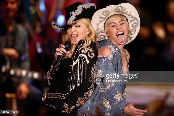 Madonna and Miley Cyrus perform onstage during Miley Cyrus MTV Unplugged at Sunset Gower Studios on January 28 2014 in Hollywood California Miley...