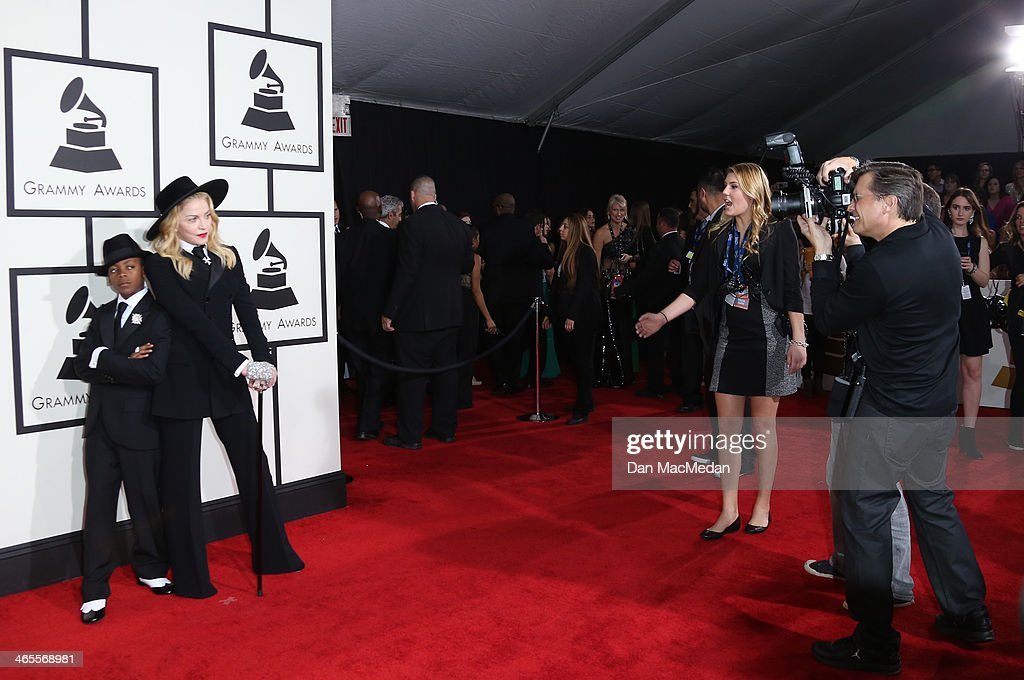 Madonna (R) and son David Banda arrive at the 56th Annual GRAMMY Awards at Staples Center on January 26, 2014 in Los Angeles, California.