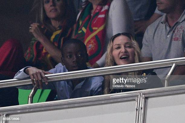 Madonna and son David Banda watch the FIFA 2018 World Cup Qualifier between Portugal and Switzerland at the Luz Stadium on October 10 2017 in Lisbon...