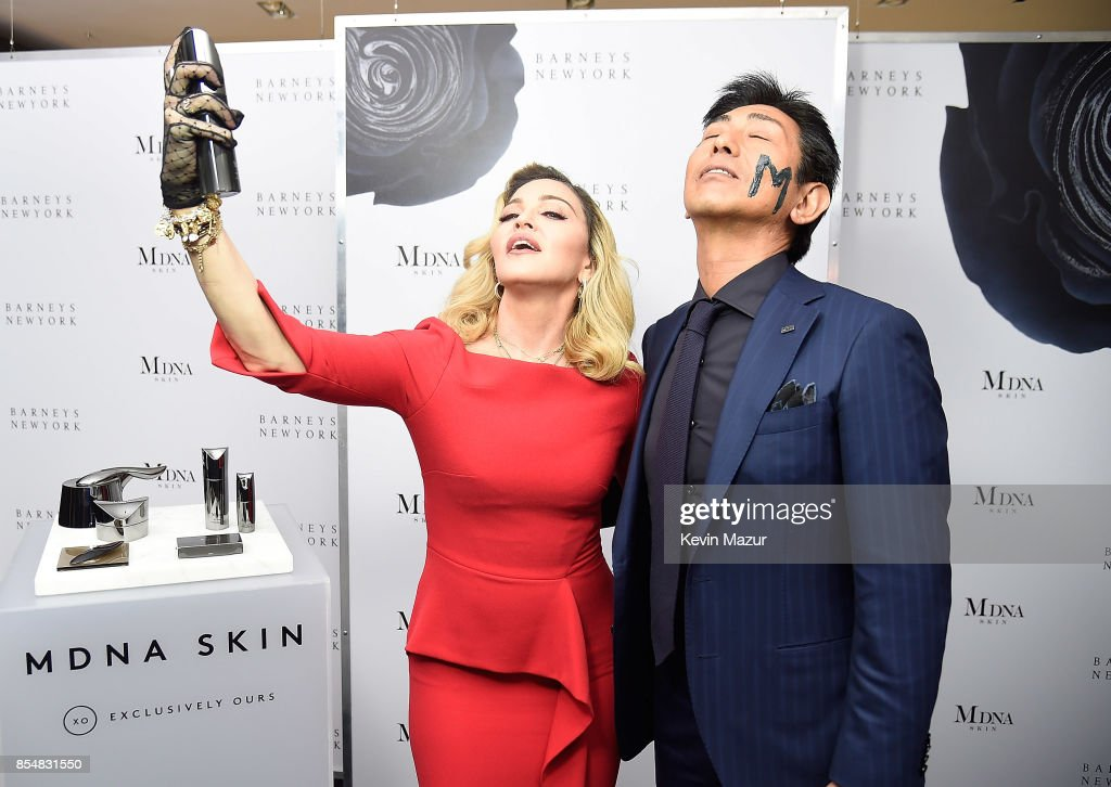 Madonna and Tsuyoshi Matsushita, President of MTG Co., Ltd launch MDNA SKIN collection at Barneys New York on September 26, 2017 in New York City.