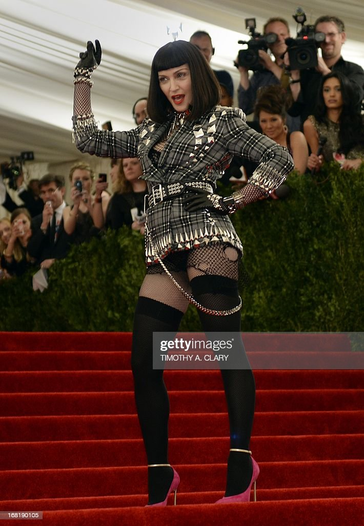 """Madonna arrives at the Metropolitan Museum of Art's Costume Institute Gala benefit in honor of the museum's latest exhibit, """"Punk: Chaos to Couture."""" May 6, 2013 in New York. AFP PHOTO/Timothy A. CLARY"""