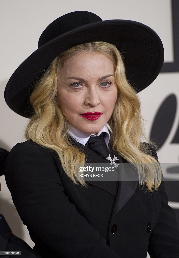 Madonna arrives on the red carpet for the 56th Grammy Awards at the Staples Center in Los Angeles on January 26 2014 AFP PHOTO/ROBYN BECK