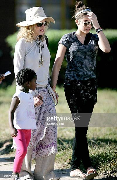 Madonna arrives with adopted Malawian Mercy James and Lourdes at one of the Raising Malawi initiative's Mphandula Childcare Centre which supports...