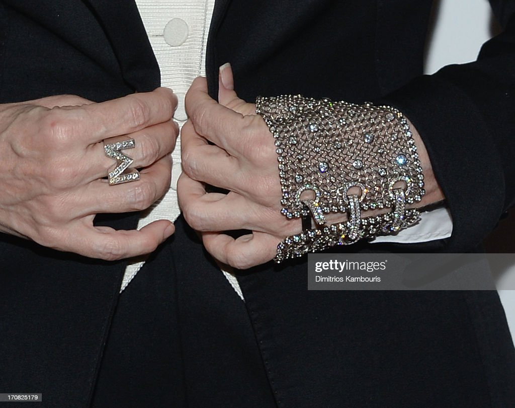 Madonna (glove detail) attends the Dolce & Gabbana and The Cinema Society screening of the Epix World premiere of 'Madonna: The MDNA Tour' at The Paris Theatre on June 18, 2013 in New York City.