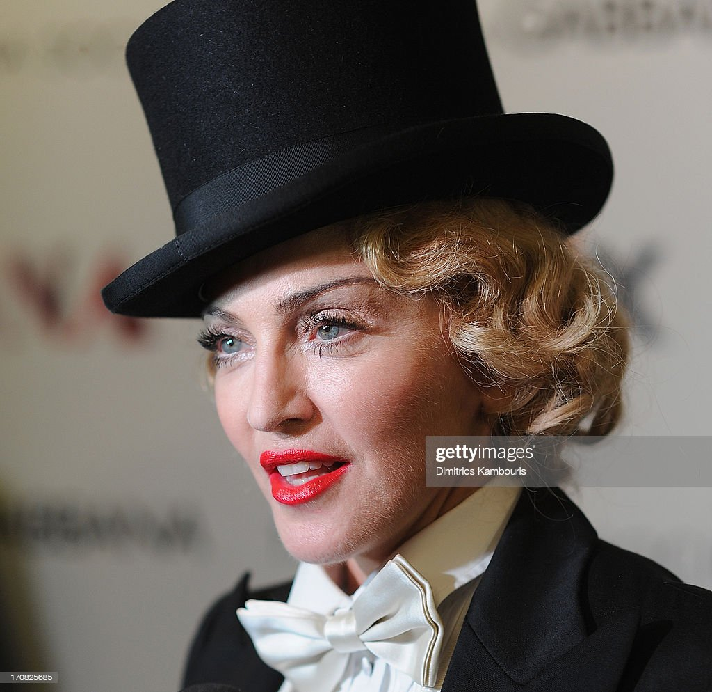 <a gi-track='captionPersonalityLinkClicked' href=/galleries/search?phrase=Madonna+-+Zangeres&family=editorial&specificpeople=156408 ng-click='$event.stopPropagation()'>Madonna</a> attends the Dolce & Gabbana and The Cinema Society screening of the Epix World premiere of '<a gi-track='captionPersonalityLinkClicked' href=/galleries/search?phrase=Madonna+-+Zangeres&family=editorial&specificpeople=156408 ng-click='$event.stopPropagation()'>Madonna</a>: The MDNA Tour' at The Paris Theatre on June 18, 2013 in New York City.