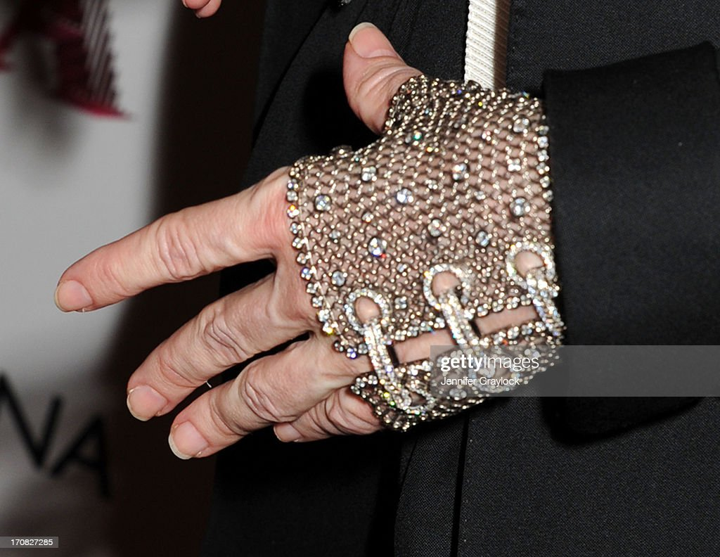 Madonna (jewelry detail) attends the Dolce & Gabbana and The Cinema Society screening of the Epix World premiere of 'Madonna: The MDNA Tour' at The Paris Theatre on June 18, 2013 in New York City.