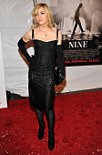 Madonna attends the New York premiere of 'NINE' sponsored by Chopard at the Ziegfeld Theatre on December 15 2009 in New York City