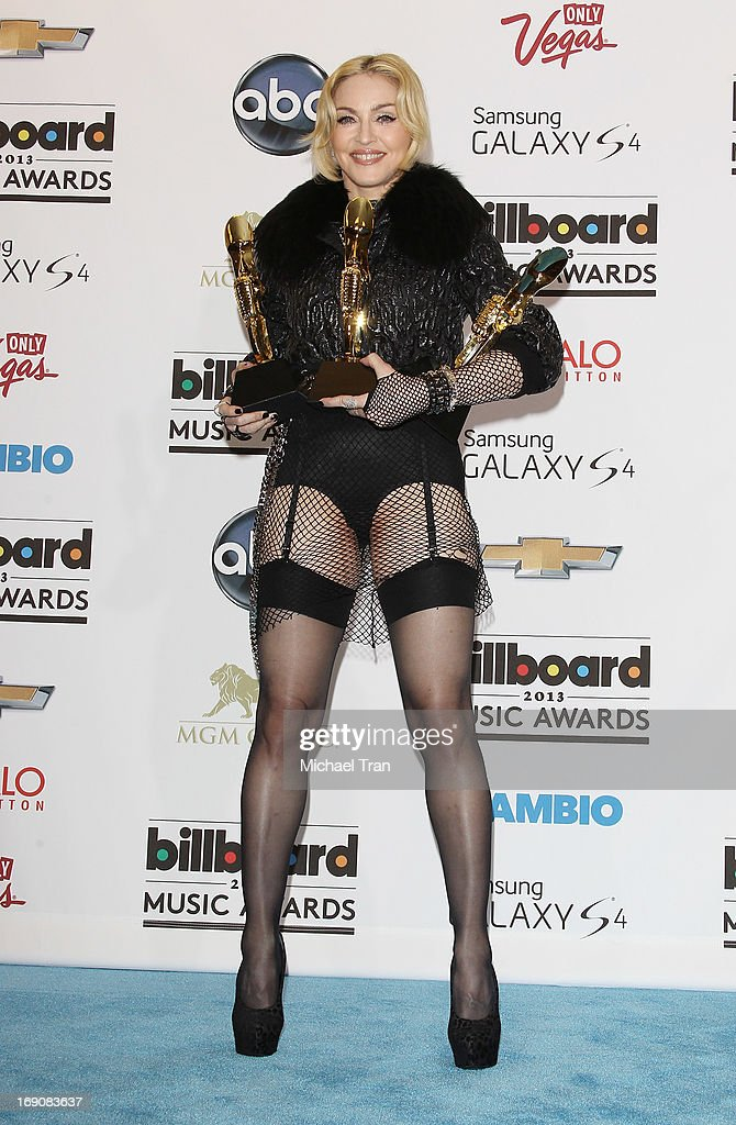 <a gi-track='captionPersonalityLinkClicked' href=/galleries/search?phrase=Madonna+-+Singer&family=editorial&specificpeople=156408 ng-click='$event.stopPropagation()'>Madonna</a> attends the press room at the 2013 Billboard Music Awards held at MGM Grand Resort and Casino on May 19, 2013 in Las Vegas, Nevada.