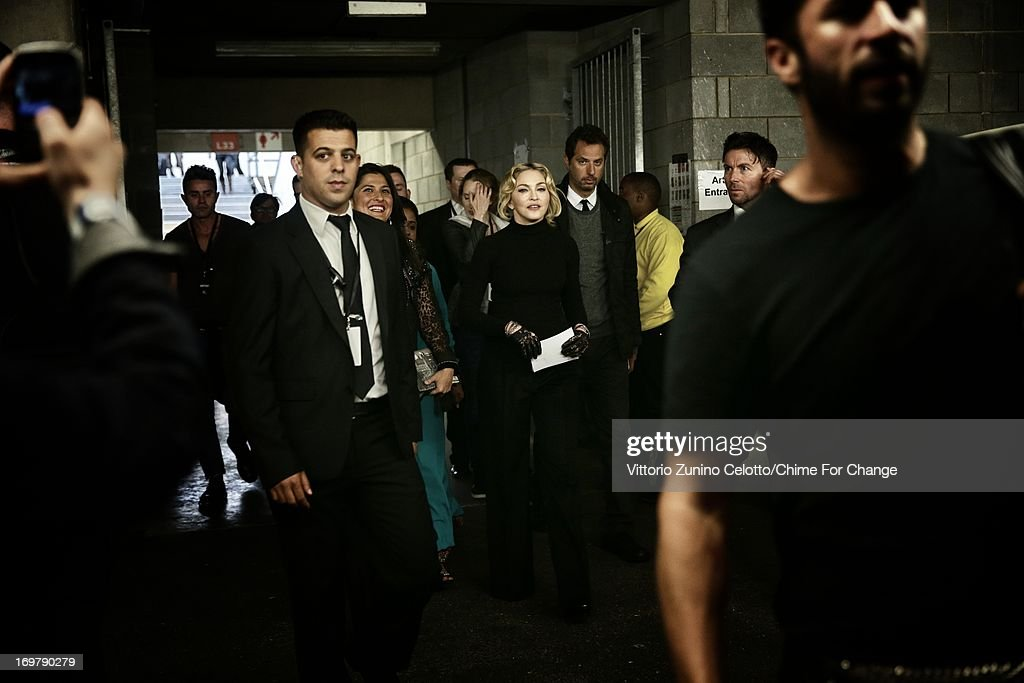 <a gi-track='captionPersonalityLinkClicked' href=/galleries/search?phrase=Madonna+-+Singer&family=editorial&specificpeople=156408 ng-click='$event.stopPropagation()'>Madonna</a> backstage at the 'Chime For Change: The Sound Of Change Live' Concert at Twickenham Stadium on June 1, 2013 in London, England. Chime For Change is a global campaign for girls' and women's empowerment founded by Gucci with a founding committee comprised of Gucci Creative Director Frida Giannini, Salma Hayek Pinault and Beyonce Knowles-Carter.