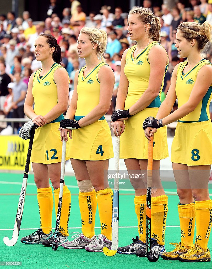 Madonna Blyth Casey Eastham Jodie Schulz and Ashleigh Nelson of Australia line up the national anthems during the grand final match between Australia...