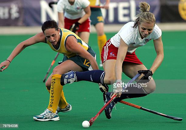Madonna Blyth of Australia and Kate Walsh of Great Britain contest the ball during the second test match between the Australian Hockeyroos and Great...