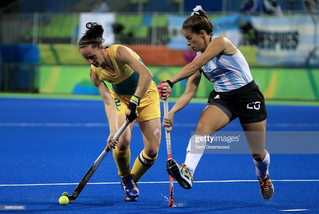 Madonna Blyth of Australia attempts to run past Lucina Von der Heyde of Argentina during a Women's Preliminary Pool B match at the Olympic Hockey...