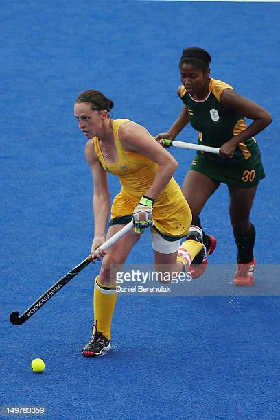 Madonna Blyth of Australia challenges Sulette Damons of South Africa for the ball during the Women's Hockey match between Australia and South Africa...
