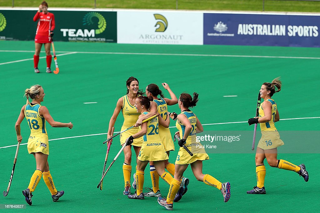 Madonna Blyth of Australia is congratulated by team mates after scoring a goal during the International Test match between the Australian Hockeyroos and Korea at Perth Hockey Stadium on April 27, 2013 in Perth, Australia.