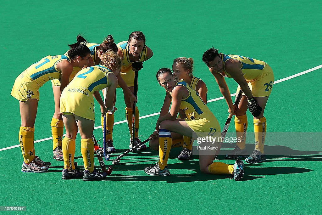 Madonna Blyth of Australia looks on as the Hockeyroos discuss a corner play during the International Test match between the Australian Hockeyroos and...