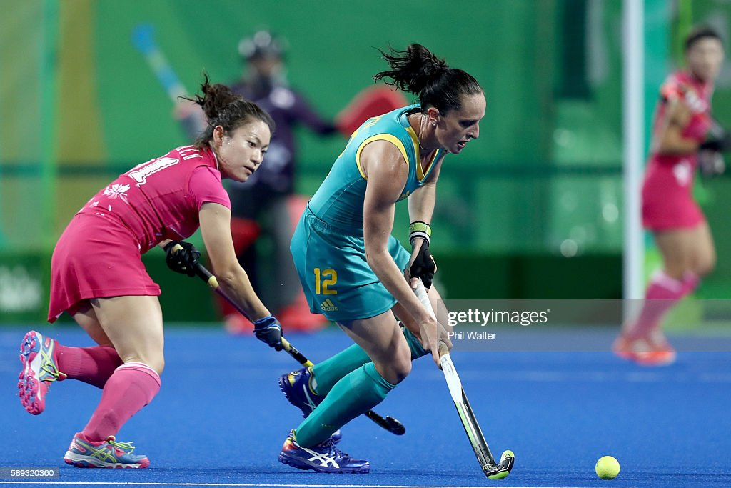 Madonna Blyth of Australia passes the ball in the Women's Pool B match between Australia and Japan on Day 8 of the Rio 2016 Olympic Games at the...