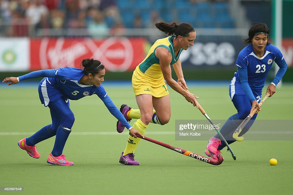 Madonna Blyth of Australia runs with the ball during the Women's preliminary match between Australia and Malaysia at Glasgow National Hockey Centre...