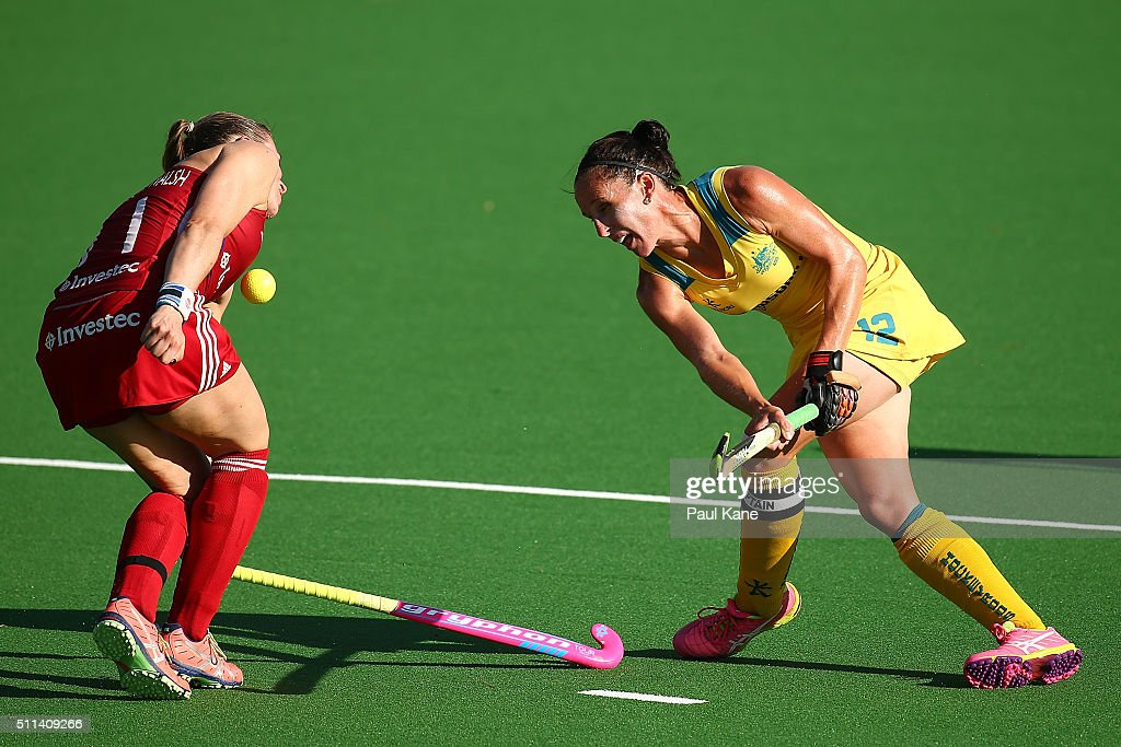 Madonna Blyth of Australia shoots on goal against Kate RichardsonWalsh of Great Britain during the International Test match between the Australian...