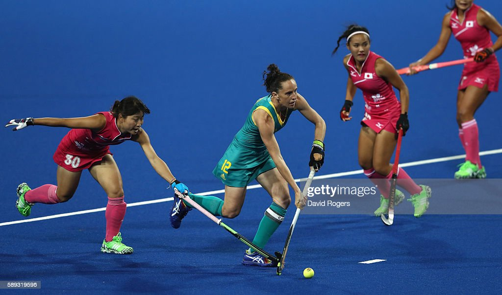 Madonna Blyth of Australlia moves past Minami Shimizu during the Women's Pool B hockey match between Australia and Japan on Day 8 of the Rio 2016...