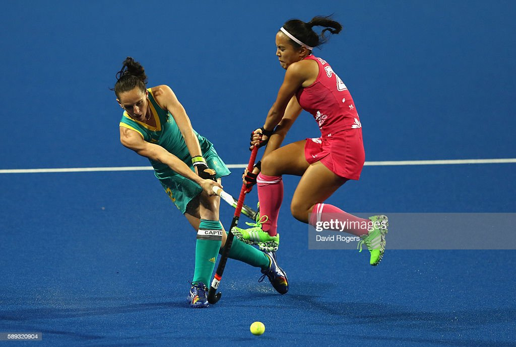 Madonna Blyth of Australlia plays the ball past Motomi Kawamura during the Women's Pool B hockey match between Australia and Japan on Day 8 of the...