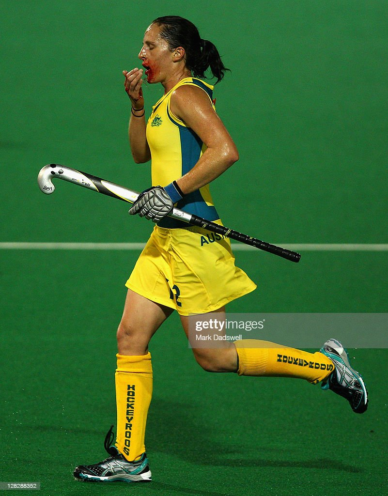 Madonna Blyth of the Hockeyroos leaves the field bleeding during the Oceania Cup match between New Zealand and Australia at Hobart Hockey Centre on...