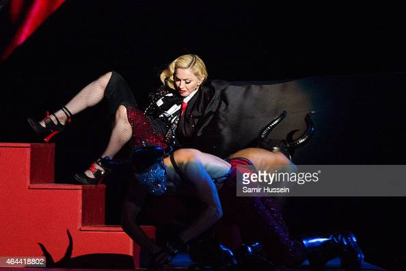 Madonna falls as she performs on stage for the BRIT Awards 2015 at The O2 Arena on February 25 2015 in London United Kingdom