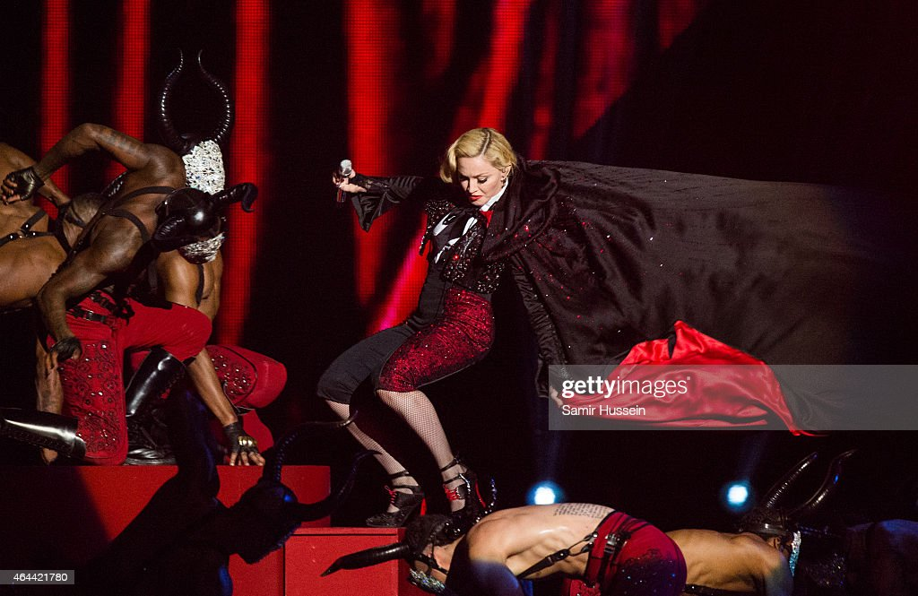 Madonna falls as she performs on stage for the BRIT Awards 2015 at The O2 Arena on February 25, 2015 in London, United Kingdom