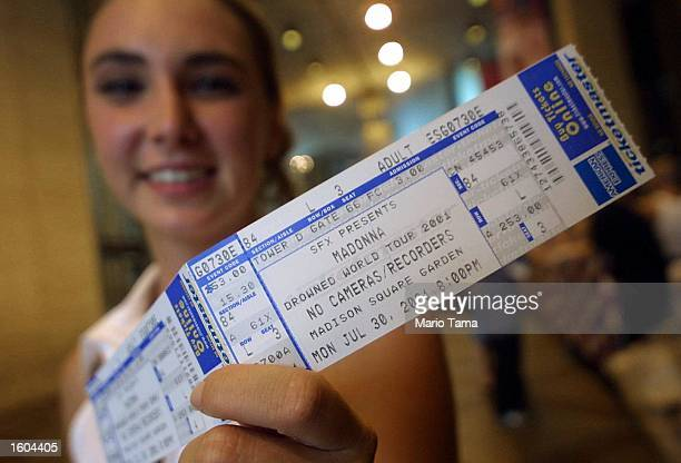 Madonna fan holds a cherished ticket prior to Madonna''s concert July 25 2001 at Madison Square Garden in New York City