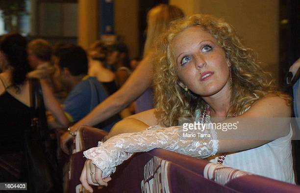 Madonna fan Kristen Rossi waits in line for last minute tickets prior to Madonna''s concert July 25 2001 at Madison Square Garden in New York City