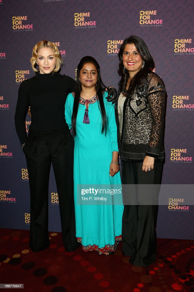 <a gi-track='captionPersonalityLinkClicked' href=/galleries/search?phrase=Madonna+-+Singer&family=editorial&specificpeople=156408 ng-click='$event.stopPropagation()'>Madonna</a>, Humaira Bachal and Sharmeen Obaid-Chinoy pose backstage in the media room at the 'Chime For Change: The Sound Of Change Live' Concert at Twickenham Stadium on June 1, 2013 in London, England. Chime For Change is a global campaign for girls' and women's empowerment founded by Gucci with a founding committee comprised of Gucci Creative Director Frida Giannini, Salma Hayek Pinault and Beyonce Knowles-Carter.
