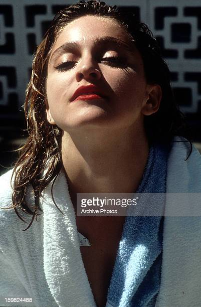 Madonna in a robe with wet hair in a scene from the film 'Desperately Seeking Susan' 1985