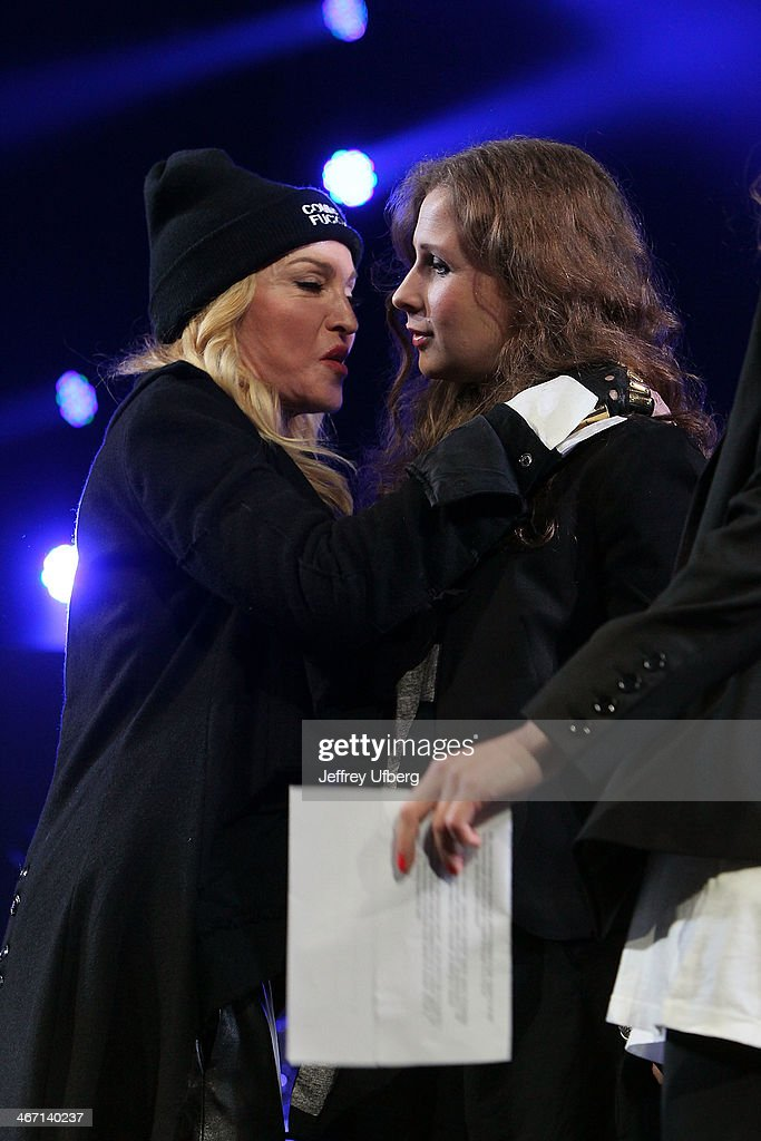 Madonna introduces Maria Alyokhina during the Amnesty International 'Bringing Human Rights Home' Concert at the Barclays Center on February 5, 2014 in the Brooklyn borough of New York City.