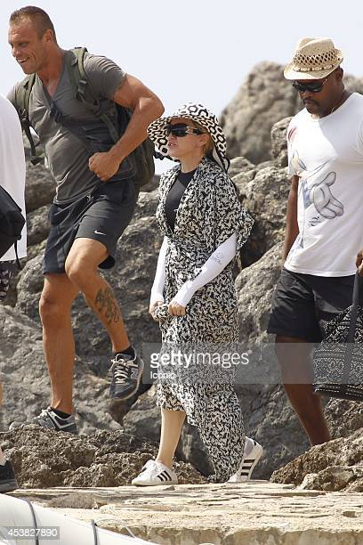 Madonna is pictured getting on a boat in Ibiza on August 19 2014 in Ibiza