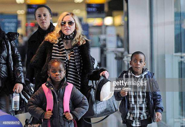 Madonna is seen at Heathrow airport with her children son David Banda Ritchie and Mercy on April 02 2011 in London United Kingdom