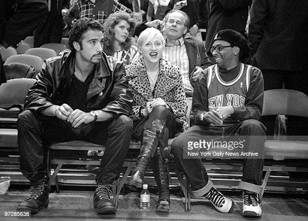 Madonna joins Spike Lee to watch the New York Knicks take on the Chicago Bulls at Madison Square Garden At left is Madonna's boyfriend Carlos Leon