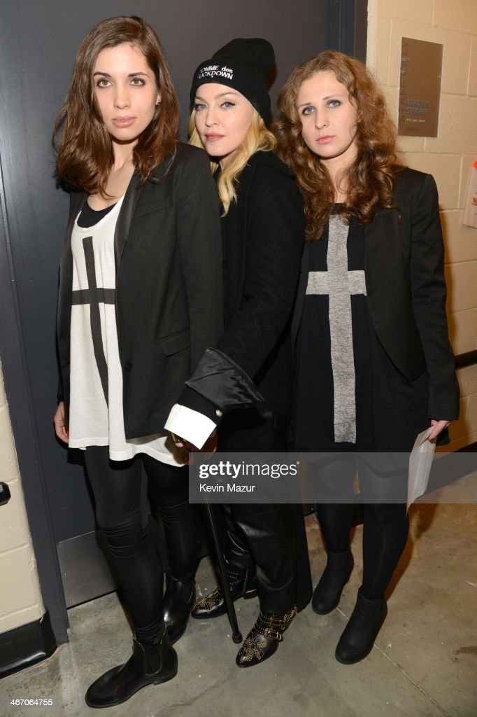 Madonna (C), Nadya Tolokonnikova (L) and Masha Alyokhina (R) of Pussy Riot attend the Amnesty International Concert presented by the CBGB Festival at Barclays Center on February 5, 2014 in New York City.