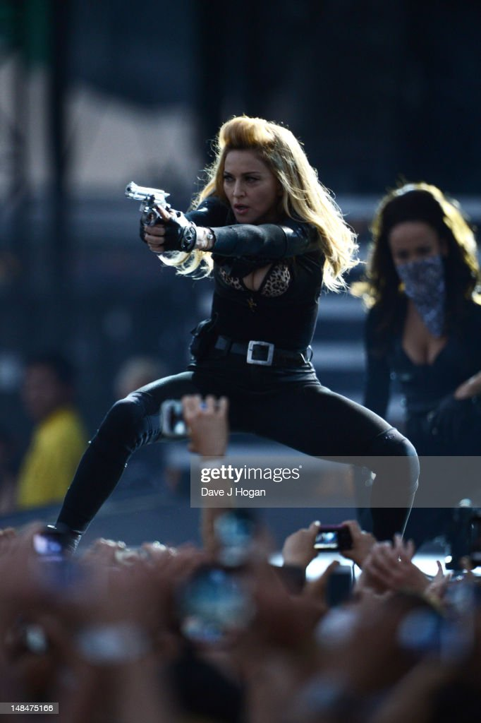 <a gi-track='captionPersonalityLinkClicked' href=/galleries/search?phrase=Madonna+-+Singer&family=editorial&specificpeople=156408 ng-click='$event.stopPropagation()'>Madonna</a> performs at the start of the UK leg of her MDNA Tour at Hyde Park on July 17, 2012 in London, England.