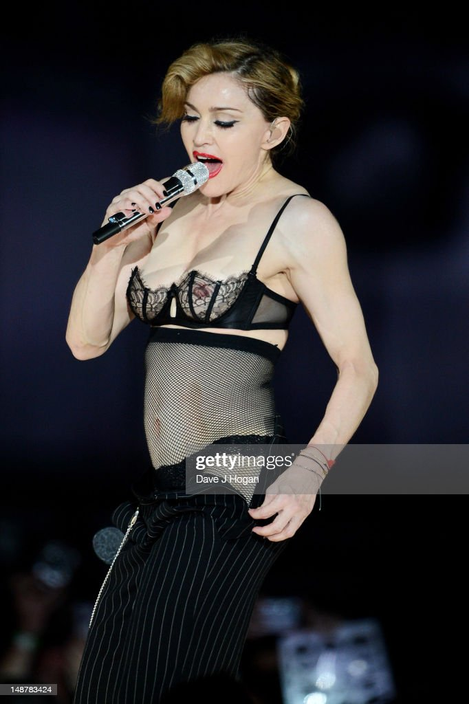 <a gi-track='captionPersonalityLinkClicked' href=/galleries/search?phrase=Madonna+-+Singer&family=editorial&specificpeople=156408 ng-click='$event.stopPropagation()'>Madonna</a> performs during her MDNA Tour at The NIA Arena on July 19, 2012 in Birmingham, England.