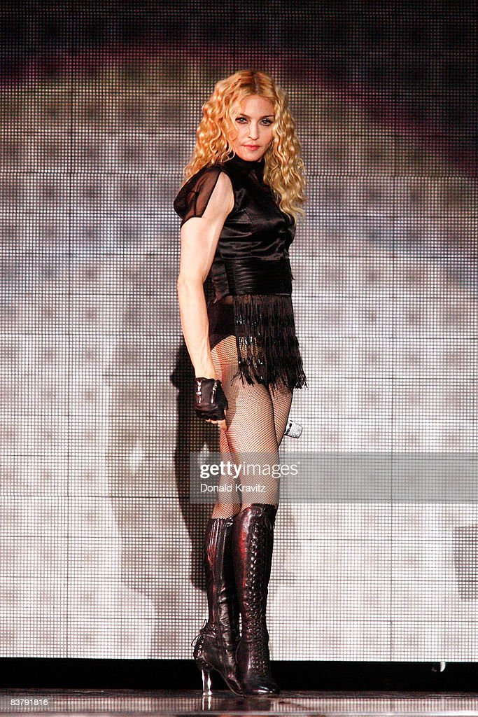 <a gi-track='captionPersonalityLinkClicked' href=/galleries/search?phrase=Madonna+-+Cantora&family=editorial&specificpeople=156408 ng-click='$event.stopPropagation()'>Madonna</a> performs during her 'Sticky & Sweet' tour at Boardwalk Hall on November 22, 2008 in Atlantic City, New Jersey.