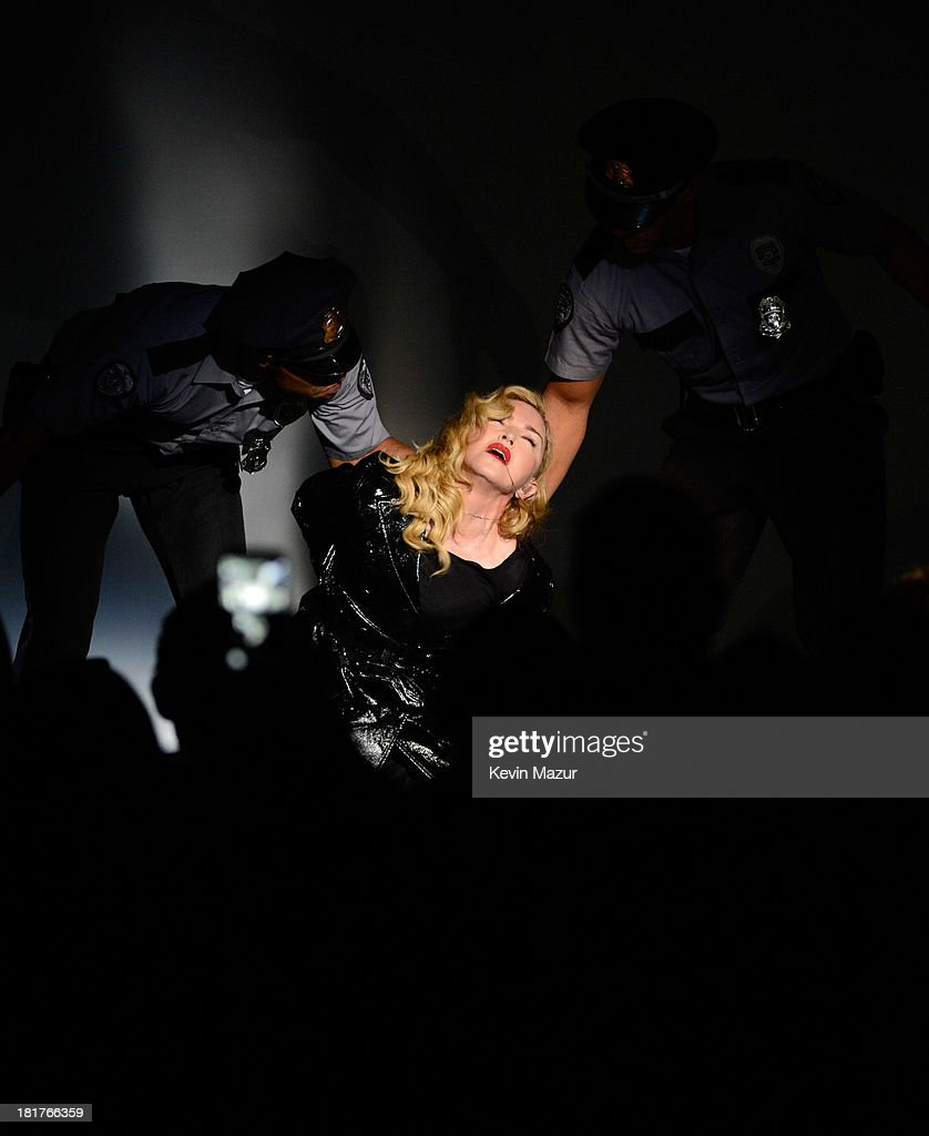 <a gi-track='captionPersonalityLinkClicked' href=/galleries/search?phrase=Madonna+-+Singer&family=editorial&specificpeople=156408 ng-click='$event.stopPropagation()'>Madonna</a> performs during <a gi-track='captionPersonalityLinkClicked' href=/galleries/search?phrase=Madonna+-+Singer&family=editorial&specificpeople=156408 ng-click='$event.stopPropagation()'>Madonna</a> and Steven Klein secretprojectrevolution at the Gagosian Gallery on September 24, 2013 in New York City.